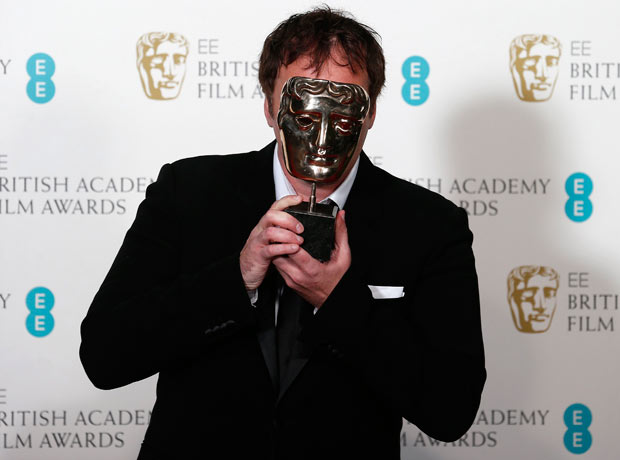 Django Unchained writer/director Quentin Tarantino holds his Bafta for best original screenplay